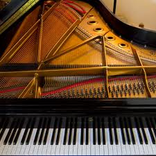 [Photo of the inside of a Steinway grand piano]