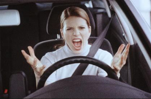 [Photo of an angry woman driver]