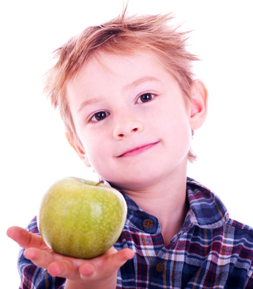 [Photo of a boy holding an apple in his outstretched hand]