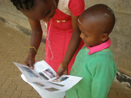 [Photo of child receiving letter]