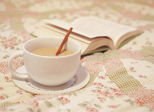 [Photo of a cup and a book]