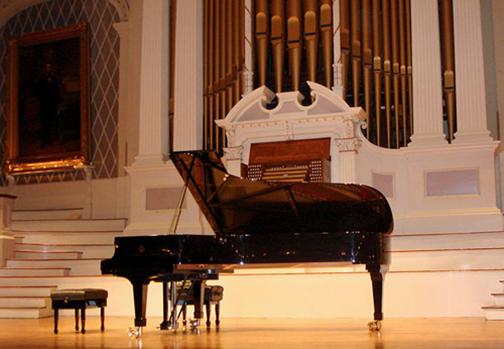 [Photo of a grand piano]