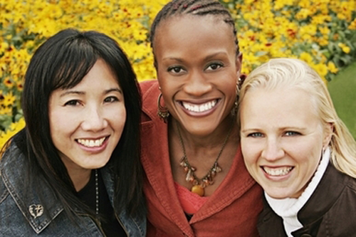 [Photo of three girls of different races]