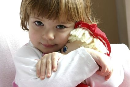 [Photo of little girl hugging her doll]