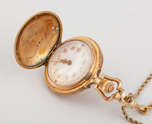 [Photo of a pocket watch]