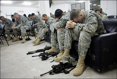 [Photo of soldiers praying]