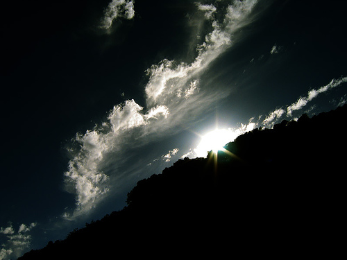[Photo of the sun rising over the dark mountains]