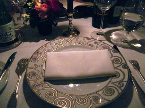 [Photo of a single table setting]