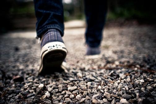 [Photo of someone walking on gravel]
