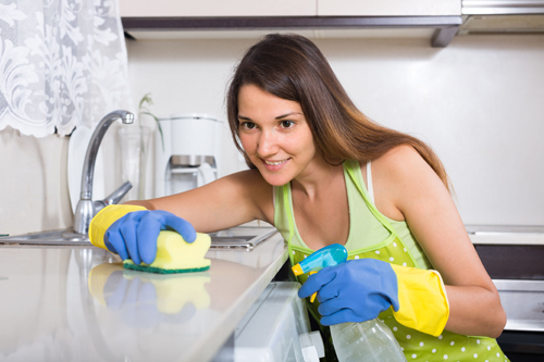 [Photo of a woman cleaning]