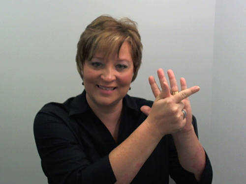 [Photo of a woman signing with American Sign Language]