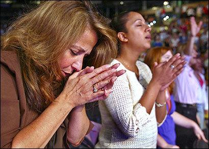 [Photo of women praying]