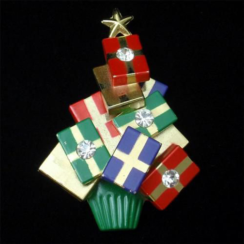 [Photo of a Christmas tree with gift box ornaments]
