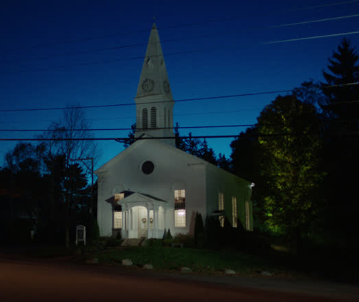 [Photo of a church at night]