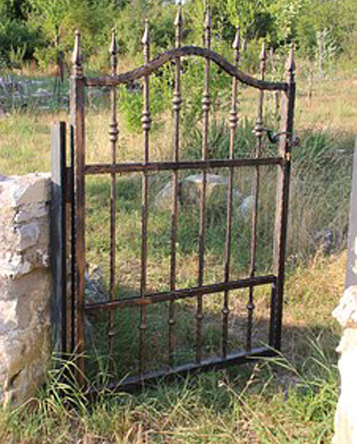 [Photo of a dilapidated gate]