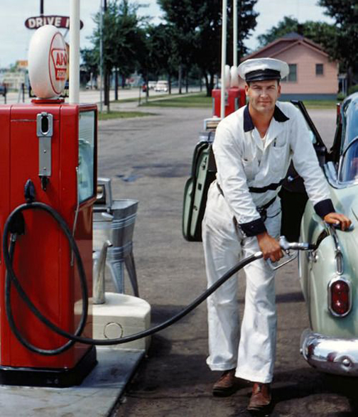 [Photo of an old fashion service station attendant]