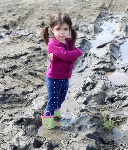 [Photo of a little girls stuck in the mud]
