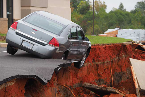 [Photo of a sinkhole]