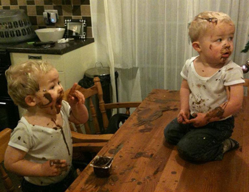 [Photo of two young boys making a mess]