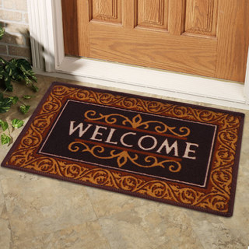 [Photo of a Welcome mat at a doorway]
